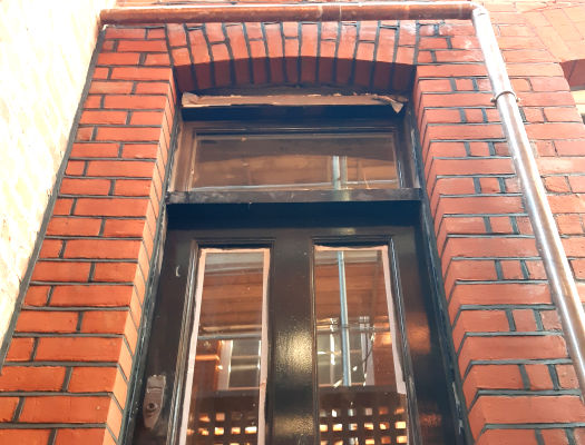 picture of a repointing done on bricks around the home entrance door